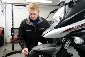 Mark at Winton Motorcycles completing a WOF