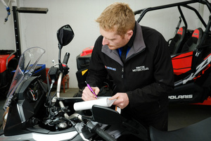 Mark at Winton Motorcycles hard at work completing a WOF